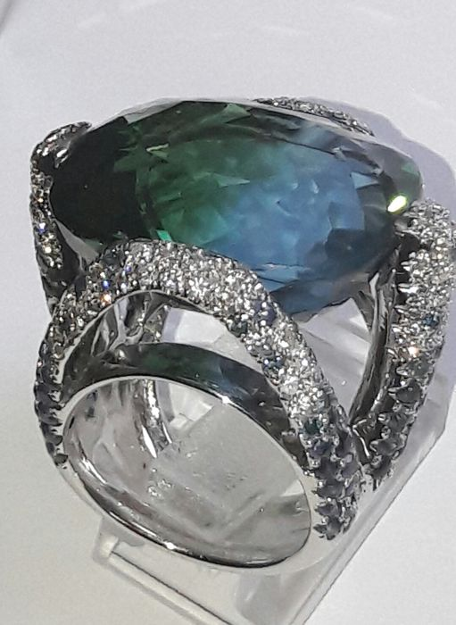 Design ring with white and blue diamonds, sapphires and multicoloured quartz. Size 51/6.25