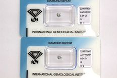 2 brilliant cut diamonds with a total of 0.48 ct, G/SI