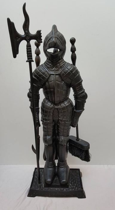 Large, cast iron fireplace set in the shape of a knight