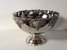 Large glossy champagne cooler with decoration of bunches of grapes