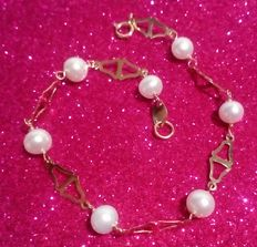 Bracelet in 18 kt (750/1000) yellow gold with freshwater cultured pearls