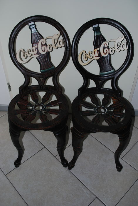 Two Coca Cola U2013 Cast Iron Chairs.