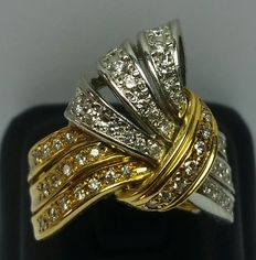 Bow-shaped ring with diamonds on platinum and yellow gold