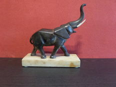 Art Deco sculpture of a Cubist elephant with ivory teeth - on marble base