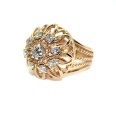 Dome ring made of pink gold thread and diamonds