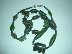 A lot of 13 unique jade,aventurine quartz elephant amulet bead  with 10 other jade and aventurine quartz and archaic glass bead in form of a neckles