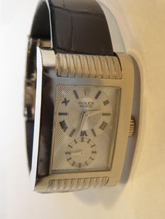 Rolex. An 18K white gold rectangular curved men's wristwatch with two-tone silvered dial. Manufactured in 2007