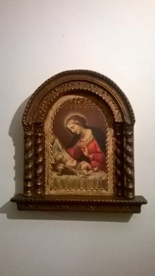 Antique Altarpiece on wood of Mary and the Child in her lap. Beginning XX Century.