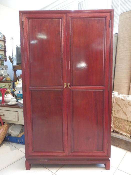A sold rosewood wardrobe with 7 shelves - China - around 1986