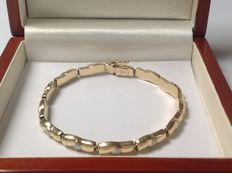 Gold bi-colour yellow gold bracelet of 14 kt with white gold accents.