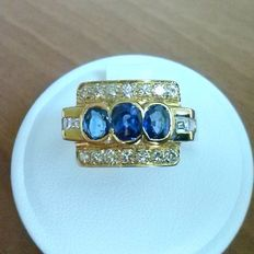Gold ring with 3 blue sapphires and diamonds