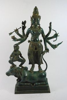 A big bronze Hindu deity sculpture, Nandi Durga, 8-armed, South East Asia - Khmer style - 2nd half of the 20th century.