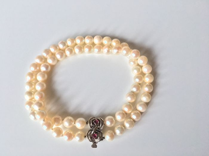 Genuine cultured salt water pearl bracelet, 2-rowed with 14 kt white gold clasp and 2 rubies
