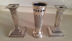 Pair of silver candlesticks, Birmingham, Sydney & Co, probably 1934 and a silver vase with blue glass liner, Birmingham, 1901,