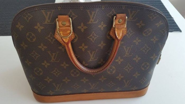 8cb47623625 Vintage Louis Vuitton Alma PM monogram canvas Handbag - Catawiki