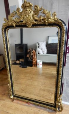 A Baroque style gilt and painted mantelpiece mirror, 20th century