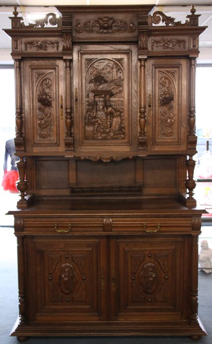 Oak Henri II buffet cabinet with carving of a couple in love ...
