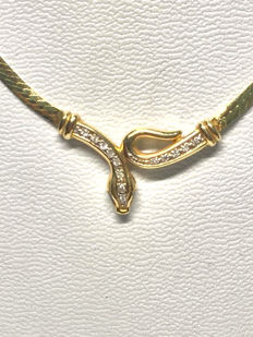Gold necklace in the shape of a snake adorned with diamonds