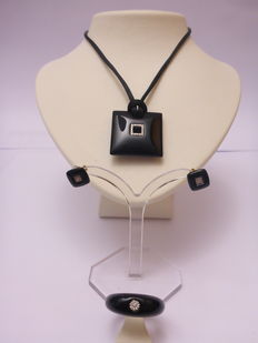 Necklace with pendant, ear studs, and ring of resin with diamond.