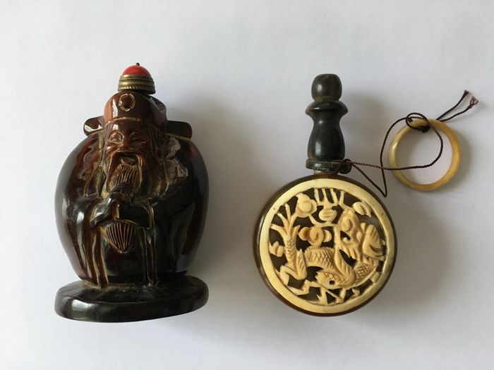 Snuff bottles - China - First half of 20th century.