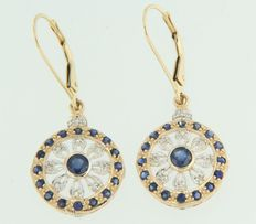 14kt bi-colour gold dangle earrings set with sapphire and diamond.
