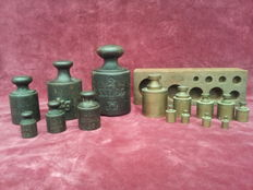 Two sets of weights of which a complete block and a set cast John Deere weights
