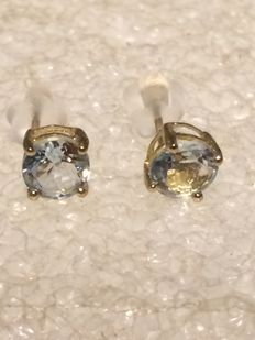 14 ct gold  blue sapphire round  earrings, each stone is  6 mm round
