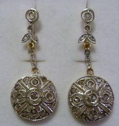 Two-tone gold earrings, with 38 diamonds.