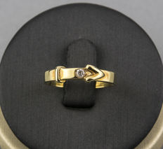 Yellow gold ring set with a central diamond.