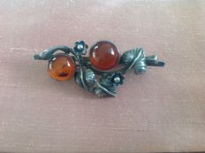 Silver brooch with two amber