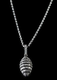 18 kt white gold honeycomb pendant. 0.32ct round brilliant diamonds, F (Colourless)colour , VS clarity with an 18 kt white gold chain 41cms long
