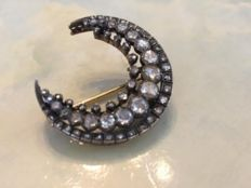 Gold and silver crescent brooch with rose cut diamonds