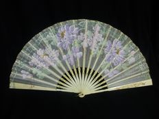 A hand painted fabric and bone folding fan - embroidered with spangles - Spain or France - circa 1900