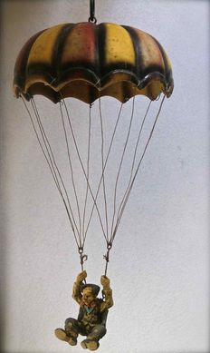 Clown hanging from a parachute