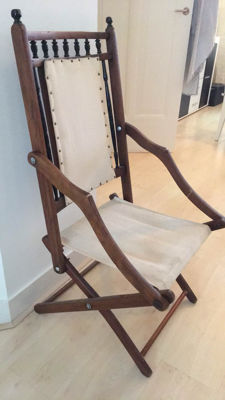 A wood and linen folding officers chair, first half 20th century
