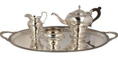 Three pieced silver tea set on serving tray, Barker Ellis Silver co, Birmingham, ca. 1974