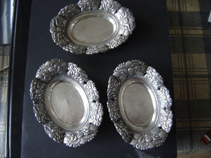 Three Yogya silver oval saucers.