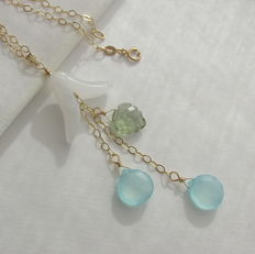 Gold necklace with white jade flower, aqua chalcedony, and leaf made of green quartz