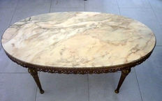 An oval living room table engraved brass legs marble top, France, second half 20th century