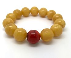 Baltic amber beads of 16.8 mm, 39.9 gr. opaque butter color