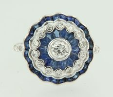 14 kt White gold Ring in art deco style, set with sapphire and old Amsterdam cut and octagon cut diamonds.