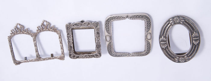 Four silver picture frames from different periods