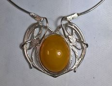 Pendant necklace with natural Baltic amber cabochon