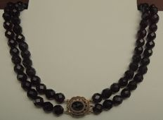 Garnet necklace: two strands and large gold clasp.