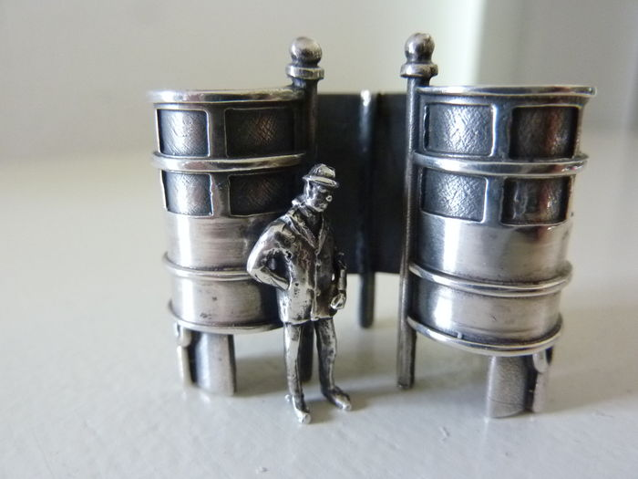 Silver miniature public toilet with person, 20th century, Dutch.