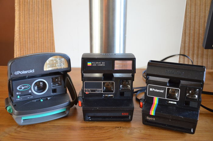 3 Polaroid cameras, the Spirit 600, the 650 land camera and the 600 cl.