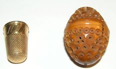 Golden thimble in a coquille nut - second half 19th century