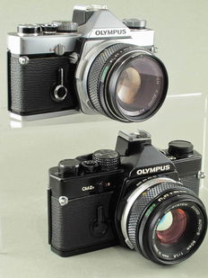 Olympus OM1 chrome and OM2n black, with accessories.
