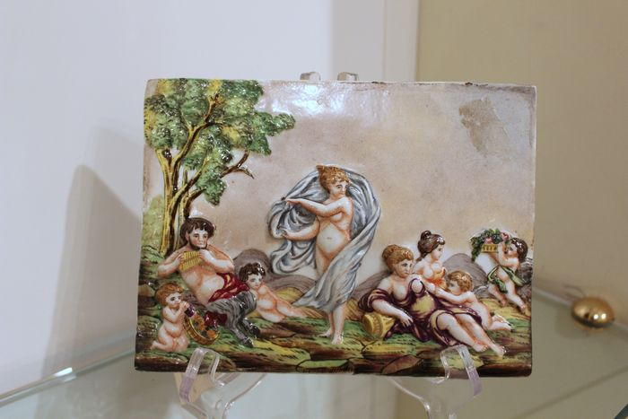 Capodimonte - Pair of painted porcelain bas-reliefs