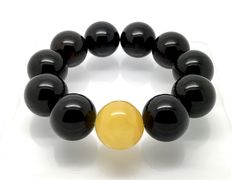 Bracelet of Baltic amber beads of 19.8 mm, weight 47 grams